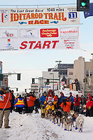Musher Mitch Seavey and Iditarider Carol Stedman.leave the 2011 Iditarod ceremonial start line in downtown Anchorage, Alaska
