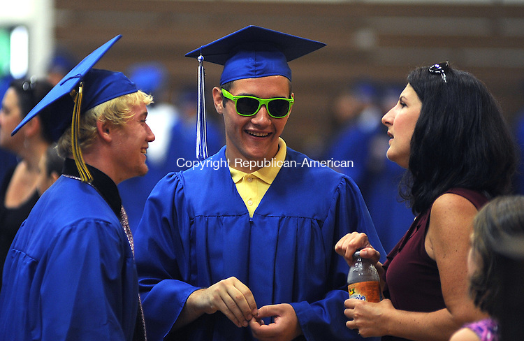 WOODBURY, CT-23 JUNE 2012--062312JS03- Jill Browne, a member of the math department, right, talks with graduates Austin Hodge, left, and Matthew Giuffre, center, prior to graduation ceremonies Saturday at Nonnewaug High School in Woodbury. Both were students is her calculus class. .Jim Shannon Republican-American