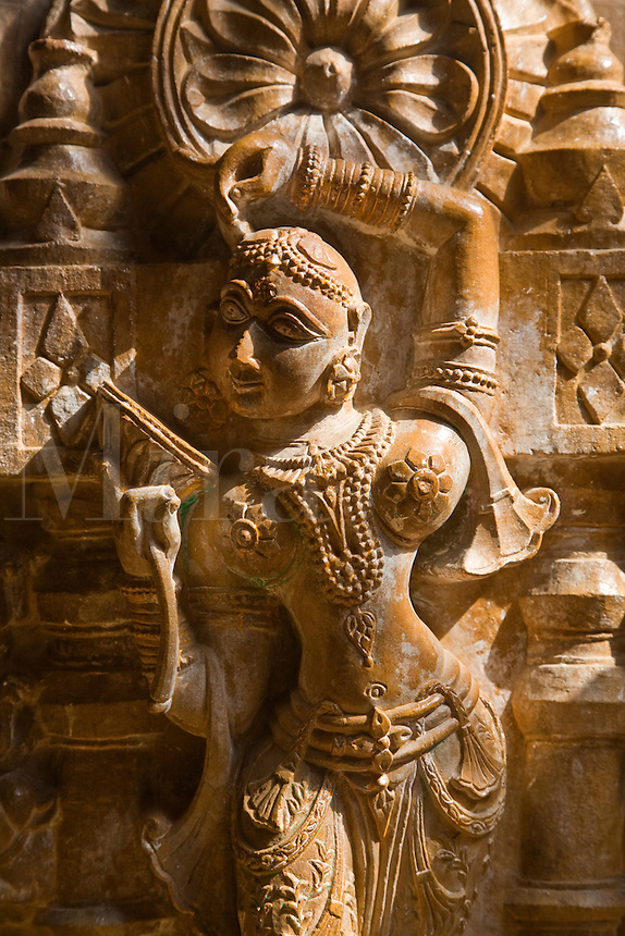 A hand carved SANDSTONE FEMALE ANGEL in the CHANDRAPRABHU JAIN TEMPLE inside JAISALMER FORT - RAJASTHAN, INDIA