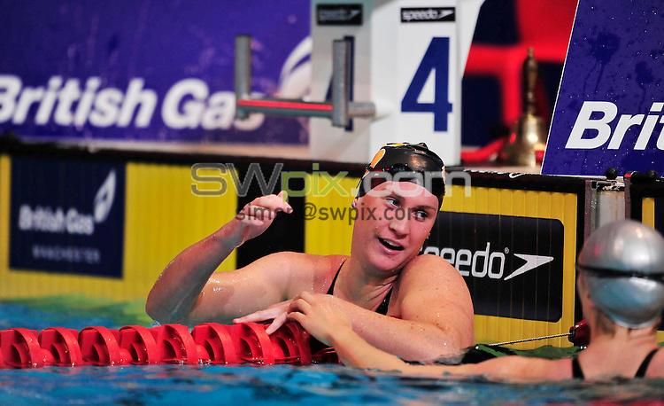 PICTURE BY SIMON WILKINSON/SWPIX.COM...Swimming - British Gas Swimming Championships 2011, Day 3 - Manchester Aquatics Centre, Manchester, England - 07/03/11...Gemma Spofforth wins Gold in the Womens 100m Backstroke Final.