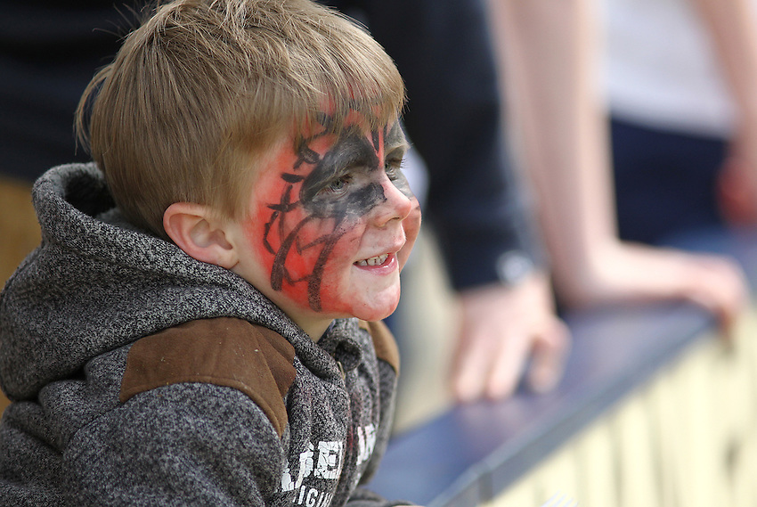 A young Preston North End fan waits for kick-off<br /> <br /> Photo by Rich Linley/CameraSport<br /> <br /> Football - The Football League Sky Bet League One - Preston v Gillingham - Saturday 26th April 2014 - Deepdale - Preston<br /> <br /> &copy; CameraSport - 43 Linden Ave. Countesthorpe. Leicester. England. LE8 5PG - Tel: +44 (0) 116 277 4147 - admin@camerasport.com - www.camerasport.com