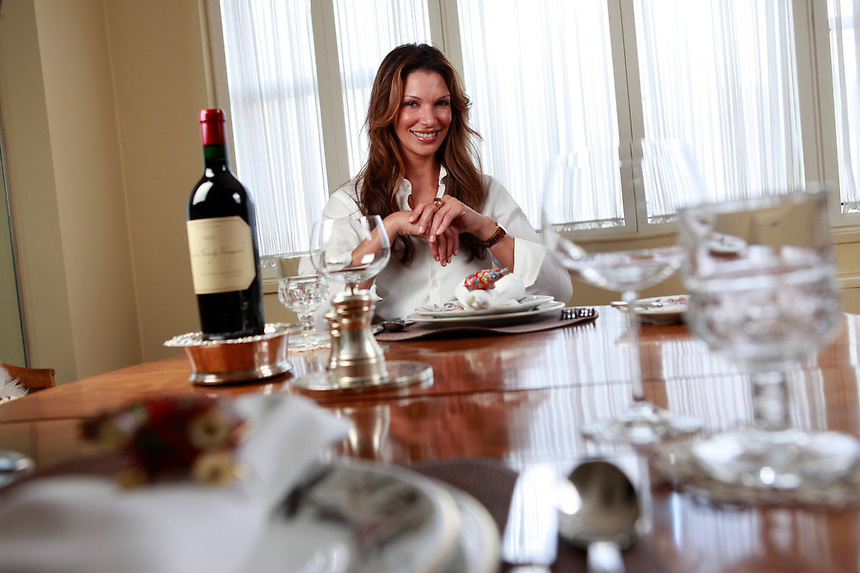 Candida Lara, 38, the 1995 Miss Dominican Republic beauty queen and a former Miss Universe contestant, poses in her Manhattan apartment.  Lara has her own business, The Etiquette Dining Company, where she teaches Wall Streeters the finer details of food etiquette.
