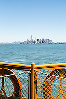View of lower Manhattan and the New York City skyline from the Staten Island Ferry. New York, New York