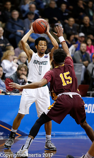 SIOUX FALLS, SD: MARCH 22: Justin Pitts #1 of Northwest Missouri State looks past St. Thomas Aquinas defender Chaz Watler #15 during the Men's Division II Basketball Championship Tournament on March 22, 2017 at the Sanford Pentagon in Sioux Falls, SD. (Photo by Dick Carlson/Inertia)