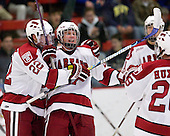 David Valek (Harvard - 22), Michael Biega (Harvard - 27) celebrate Biega's goal which ited the game at 1. - The St. Lawrence University Saints defeated the Harvard University Crimson 3-2 on Friday, November 20, 2009, at the Bright Hockey Center in Cambridge, Massachusetts.