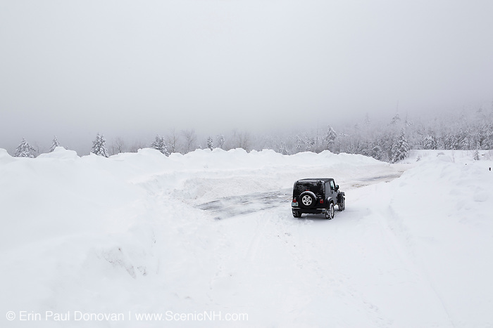 Jeep parked at C.L. Graham Wangan Grounds Scenic Overlook along the Kancamagus Highway (route 112), which is one of New England's scenic byways during a snow storm. Located in the White Mountains, New Hampshire USA
