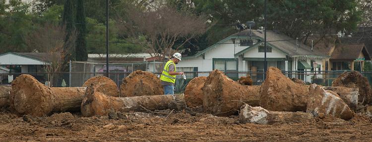 Contractor surveys demolition at Milby High School, December 18, 2014.