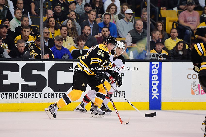 Thursday, October 20, 2016: Boston Bruins center Tim Schaller (59) carries the puck forward during the Boston Bruins home opener against the New Jersey Devils held at TD Garden, in Boston, Mass. The Bruins defeat the Devils 2-1 in regulation time. Eric Canha/CSM