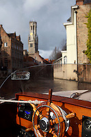 "BRUGES, BELGIUM - FEBRUARY 08 : A detail of a ship's wheel with the canal and the ""Befroi"" (Belfort) in the background on February 08, 2009 in Bruges, West Flanders, Belgium. (Photo by Manuel Cohen)"