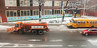 """A new York City Dept. of Sanitation salt spreader travels down Ninth Avenue in the Chelsea neighborhood of New York spreading salt on the slushy roadway on Wednesday, February 5, 2014. Because of the long winter many cities have gone through much of their stockpiles of road salt creating a shortage of the much needed commodity. Some communities are experimenting with other methods such as the product """"Beet Heet"""", made from sugar beets or mixing salt with cheese brine to extend its use.  (© Richard B. Levine)"""