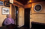 The Village Pub. The Drewe Arms. Drewsteignton, Devon, England. Interior portrait of publican Mabel Madge.