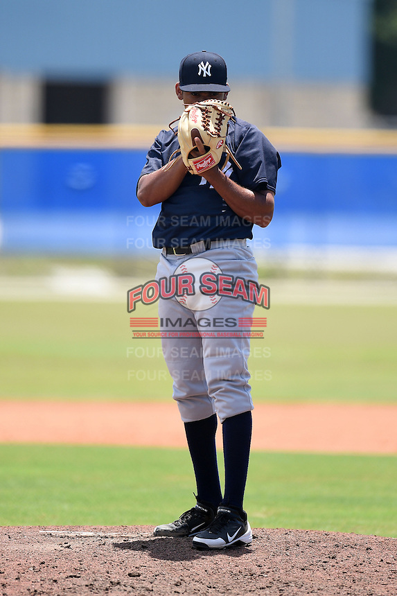 GCL Yankees 2 pitcher Jonathan Padilla (90) looks in for the sign during a game against the GCL Blue Jays on July 2, 2014 at the Bobby Mattick Complex in Dunedin, Florida.  GCL Yankees 2 defeated GCL Blue Jays 9-6.  (Mike Janes/Four Seam Images)