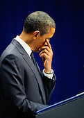 "United States President Barack Obama wipes away a tear during his speech at the event ""Together We Thrive: Tucson and America"" honoring the January 8 shooting victims at McKale Memorial Center on the University of Arizona campus on Wednesday, January 12, 2011 in Tucson, Arizona. The memorial service is in honor of victims of the mass shooting at a Safeway grocery store that killed six and injured at least 13 others, including U.S. Representative Gabrielle Giffords (Democrat of Arizona), who remains in critical condition after being shot in the head. Among those killed were U.S. District Judge John Roll, 63; Giffords' director of community outreach, Gabe Zimmerman, 30; and 9-year-old Christina Taylor Green. .Credit: Kevork Djansezian / Pool via CNP"