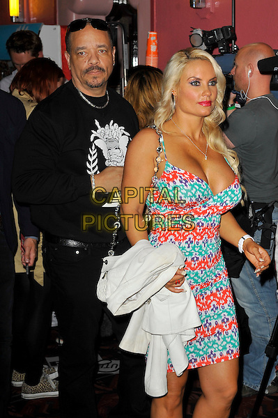 Ice T (Tracy Marrow) & Coco Austin.'Something For Nothing: The Art of Rap'  European premiere arrivals, Hammersmith Apollo, London, England. 19th July 2012..half length red green white print dress married couple husband wife black jumper sweatshirt trousers sunglasses .CAP/MAR.© Martin Harris/Capital Pictures.