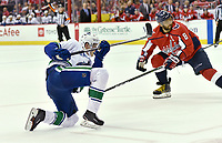 WASHINGTON, DC - FEBRUARY 05: Vancouver Canucks center Elias Pettersson (40) follows through on a goal with 6 seconds left in the game, while Washington Capitals left wing Alex Ovechkin (8) watches during the Vancouver Canucks vs. the Washington Capitals NHL game at Capital One Arena in Washington, D.C.. (Photo by Randy Litzinger/Icon Sportswire)