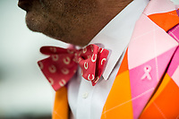 BALTIMORE, MD - MAY 20: A colorfully dressed man wears a breast cancer awareness pin on Preakness Stakes Day at Pimlico Race Course on May 20, 2017 in Baltimore, Maryland.(Photo by Douglas DeFelice/Eclipse Sportswire/Getty Images)