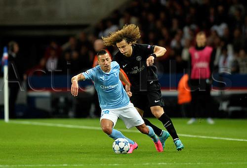 15.09.2015. Paris, France. UEFA Champions League football. Paris St Germain versus Malmo.  David Luiz (psg) gets around Nikola Djurdjic (mal)
