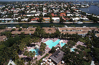 Aerial of resort swimming pool, canal-side homes, and Intracoastal Waterway (right). Fort Lauderdale, Florida.
