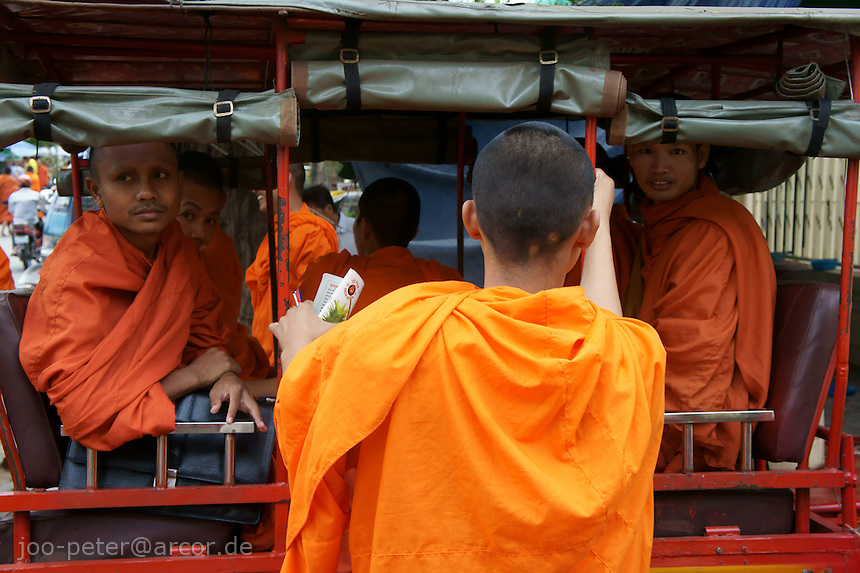 monks returning to monastery after visiting lecture at buddist university in Phnom Penh, Cambodia, August 2011