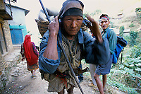 A Nepali farmer with a traditional knife in Rolpa District