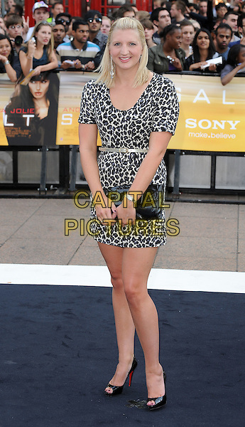 "REBECCA ADLINGTON .Attending the UK Film Premiere of ""Salt"", Empire cinema, Leicester Square, London, England, UK, .August 16th 2010..full length leopard print animal dress black clutch bag belt shoes peep toe gold waist patent v-neck sweater jumper .CAP/BEL.©Tom Belcher/Capital Pictures."
