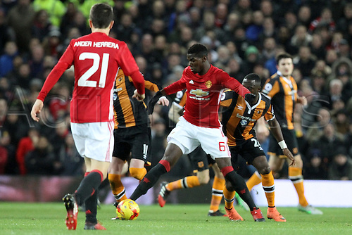 10.01.2017.  Old Trafford, Manchester, Lancashire, England. EFL Cup semi-final 1st leg, Manchester United versus Hull FC. Paul Pogba of Manchester United controls the ball as he is closed down by Hull midfielders.