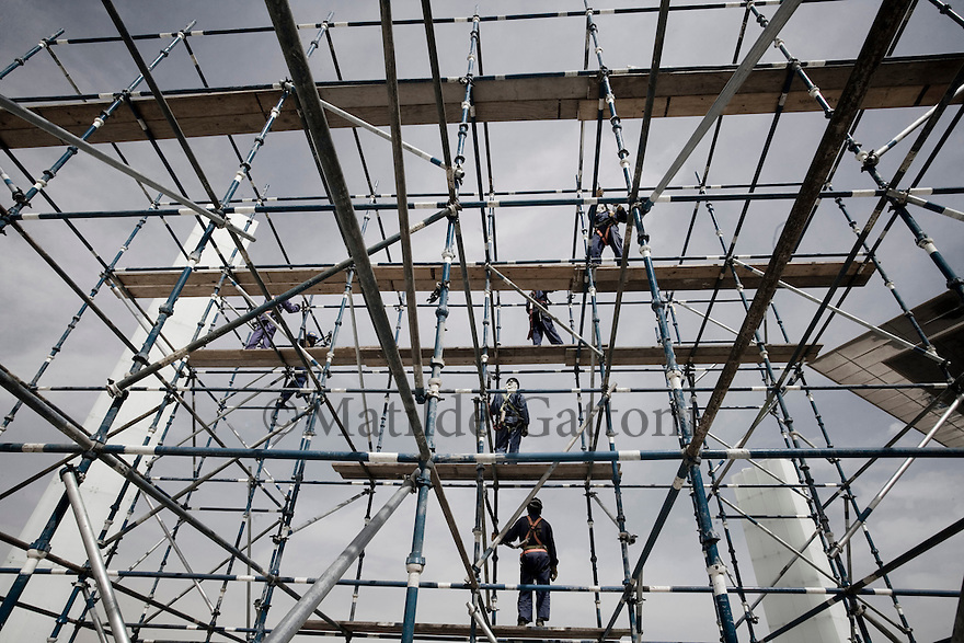 Qatar - Doha - Workers on a construction site.