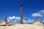 """""""Pompey's Pillar"""" dates back to the third century A.D. It is a 25m tall red granite column, include two pink granite sphinxes, constructed in honour of the Emperor Diocletian, originally from the Temple of Serapis. Alexandria Egypt"""