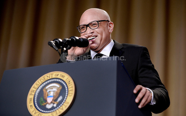 Comedian Larry Wilmore speaks during the White House Correspondents' Association annual dinner on April 30, 2016 at the Washington Hilton hotel in Washington.This is President Obama's eighth and final White House Correspondents' Association dinner.<br /> Credit: Olivier Douliery / Pool via CNP/MediaPunch