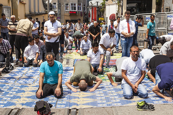 Muslims praying during Friday prayers in a street near Taksim Square, Istanbul, Turkey  May 2015.<br /> CAP/MEL<br /> &copy;MEL/Capital Pictures /MediaPunch ***NORTH AND SOUTH AMERICA ONLY***