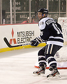 Brett Kostolansky (UNH - 15) - The University of Maine Black Bears defeated the University of New Hampshire Wildcats 5-4 in overtime on Saturday, January 7, 2012, at Fenway Park in Boston, Massachusetts.