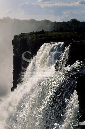 Victoria Falls, Zambia and Zimbabwe border. The waterfall in the gorge with spray mist.