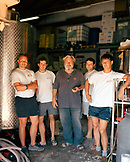 CROATIA, Hvar, Dalmatian Coast, Vintner Andro Tomic with his workers in his winery Bastijana on the island of Hvar. He makes Prosek.