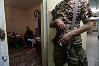 Pro-Russian rebels guards the Ukrainian soldier captured during fighting near Illovaysk. Donetsk, Eastern Ukraine