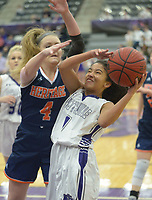 NWA Democrat-Gazette/ANDY SHUPE<br /> Naomi Logan (1) of Fayetteville takes a shot as Faith Rohrbough of Heritage defends Tuesday, Feb. 13, 2018, during the first half of play in Bulldog Arena in Fayetteville. Visit nwadg.com/photos to see more photographs from the games.