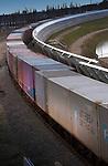 ROTTERDAM - Timeframe-opname van een goederentrein die in Rotterdam over de voormalige, nu tot Betuweroute omgebouwde havenspoorlijn rijdt. Om geluidsoverlast te beperken is een groot deel van de spoorbaan afgebakend met hoge betonnen geluidsschermen. De met zeecontainers geladen goederentrein werd nu nog getrokken door een dieseltrein, maar zal later via hoogspanning worden aangedreven. COPYRIGHT TON BORSBOOM