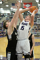 Fayetteville's Hank Gibbs (15) takes a shot Friday, Jan. 17, 2020, over Bentonville's Brayden Freeman during the first half of play in Bulldog Arena in Fayetteville. Visit nwaonline.com/prepbball/ for a gallery from the games.<br /> (NWA Democrat-Gazette/Andy Shupe)