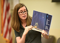 """NWA Democrat-Gazette/FLIP PUTTHOFF <br /> FLAG ON THE MOON<br /> Kayla Thornton with the Bentonville Public Library reads a story to children Wednesday July 3 2019 about the first lunar landing that took place July 20, 1969. The story was part of the """"Salute to the Flag"""" activity for children. Kids learned about the 50th anniversary of the moon landing and painted their own American Flag."""