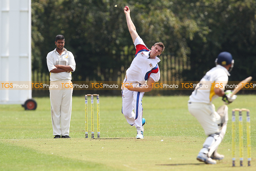James Coote in bowling action for Hornchurch Athletic - Rainham CC (batting) vs Hornchurch Athletic CC - Mid-Essex Cricket League at Spring Farm Park - 19/07/14 - MANDATORY CREDIT: Gavin Ellis/TGSPHOTO - Self billing applies where appropriate - contact@tgsphoto.co.uk - NO UNPAID USE
