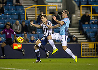 Tony Craig Captain of Millwall and Garry Thompson of Wycombe Wanderers during the Checkatrade Trophy round two Southern Section match between Millwall and Wycombe Wanderers at The Den, London, England on the 7th December 2016. Photo by Liam McAvoy.