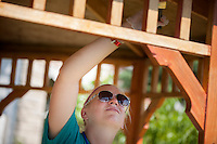 "Lauren Herneisey applies wood stain to a gazebo during ""Circle the City with Service,"" the Kiwanis Circle K International's 2015 Large Scale Service Project, on Wednesday, June 24, 2015, in Indianapolis. (Photo by James Brosher)"