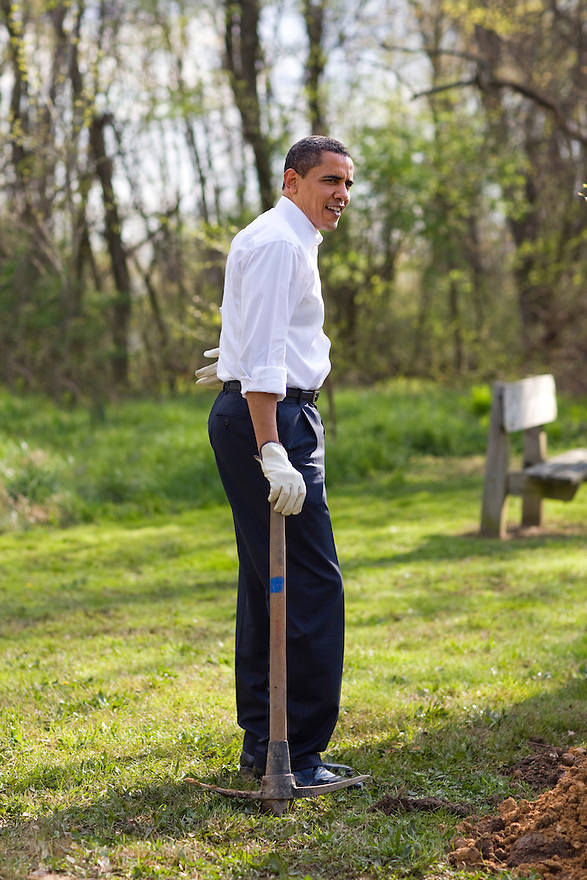 President Barack Obama participates in a national service project at Kenilworth Aquatic Garden in Washington...Photo by Brooks Kraft/Corbis......................