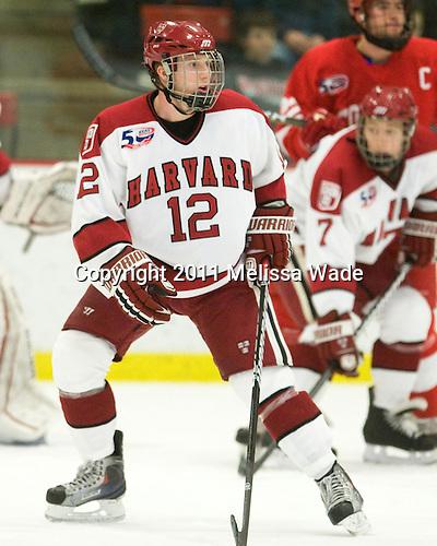 Colin Moore (Harvard - 12) - The visiting Cornell University Big Red defeated the Harvard University Crimson 2-1 on Saturday, January 29, 2011, at Bright Hockey Center in Cambridge, Massachusetts.