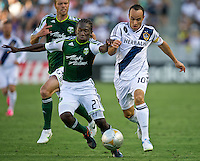 CARSON, CA - June 17, 2012: Portland Timbers midfielder Diego Chara (21) and LA Galaxy forward Landon Donovan (10) during the LA Galaxy vs Portland Timbers match at the Home Depot Center in Carson, California. Final score LA Galaxy 1, Portland Timbers 0.
