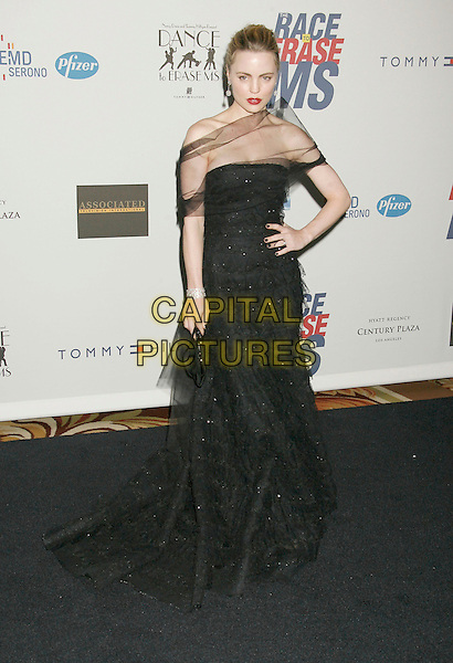 """MELISSA GEORGE.14th Annual Race to Erase MS Themed """"Dance to Erase MS"""" held at the Century Plaza Hotel, Century City, California, USA, 13 April 2007..full length sheer black wrap dress red lisptick hand on hip.CAP/ADM/RE.©Russ Elliot/AdMedia/Capital Pictures."""