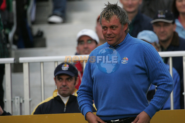 Ryder Cup 206 K Club, Straffin, Ireland...European Ryder cup team player Darren Clarke getting ready on the First Tee watched by team member Paul McGinley during the morning fourballs session of the second day of the 2006 Ryder Cup at the K Club in Straffan, Co Kildare, in the Republic of Ireland, 23 September 2006...Photo: Eoin Clarke/ Newsfile.