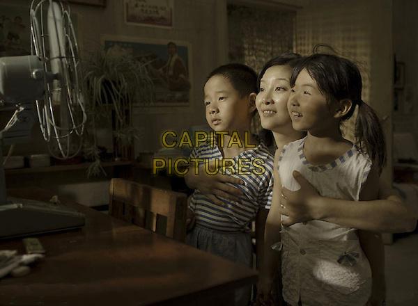 ZHANG JAIZHUN, XU FAN & ZHANG ZIFENG.in Aftershock (Tangshan dadizhen).*Filmstill - Editorial Use Only*.CAP/FB.Supplied by Capital Pictures.