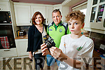 Simon Carey holds the remains of the Phone charger that went on fire also in photo are his parents Mary and Pat.