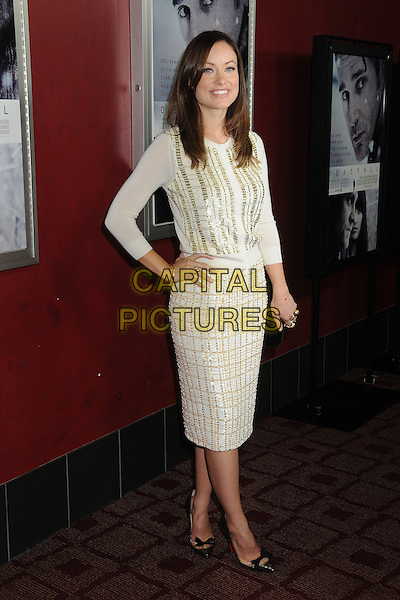 "Olivia Wilde.Attending the ""Deadfall"" Los Angeles Premiere held at Arclight Cinemas, Hollywood, California, USA, .29th November 2012..full length jumper knit cardigan skirt hand on hip cream tweed checked pointed bow black christian louboutin shoes gold white .CAP/ADM/BP.©Byron Purvis/AdMedia/Capital Pictures."