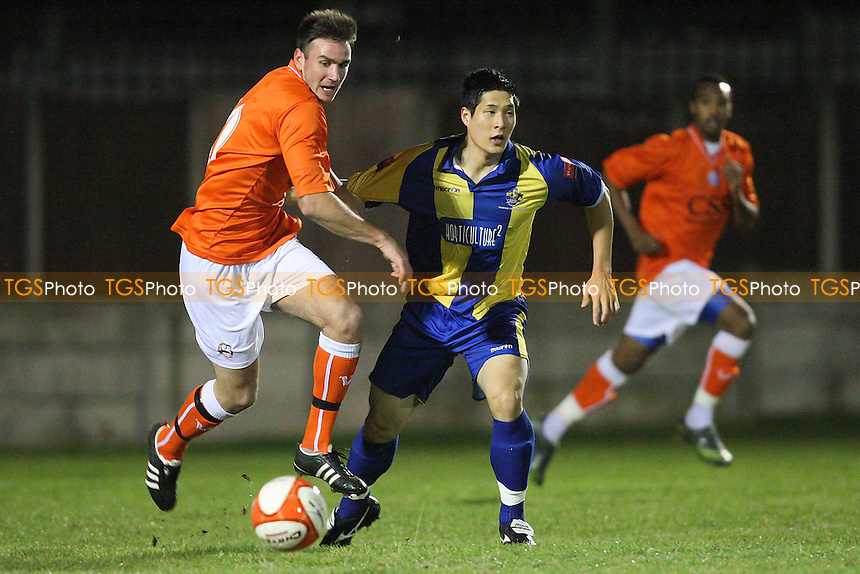 Johnson of Braintree and Hyun-Jin Lee of Romford - Romford vs Braintree Town - Essex Senior Cup 3rd Round Football at Mill Field, Aveley FC - 01/11/11 - MANDATORY CREDIT: Gavin Ellis/TGSPHOTO - Self billing applies where appropriate - 0845 094 6026 - contact@tgsphoto.co.uk - NO UNPAID USE.